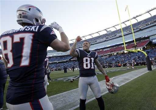 New England Patriots tight ends Rob Gronkowski (87) and Aaron Hernandez (81) get pumped up before an NFL football game against the Miami Dolphins in Foxborough, Mass., Sunday, Dec. 30, 2012. (AP Photo/Elise Amendola)