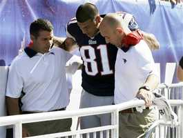 Hernandez is helped off the field after his injury in the game.
