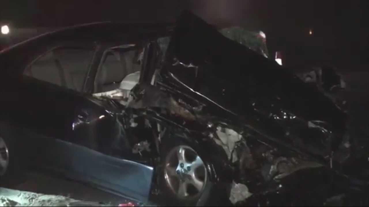 Car crashes into paving work crew