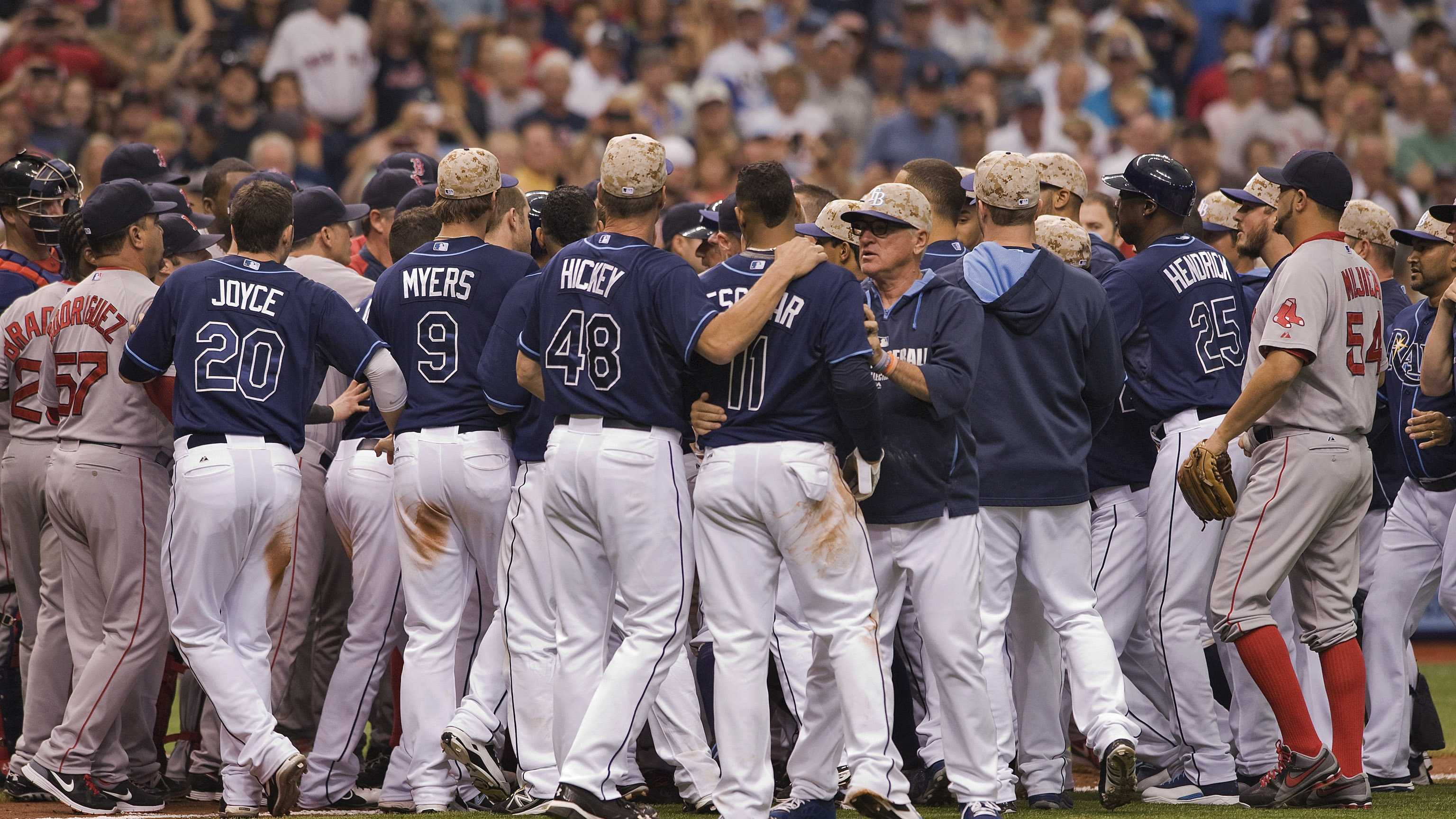 Tampa Bay Rays manager Joe Maddon ,center right, and pitching coach Jim Hickey (48) restrain Yunel Escobar (11) during a benches-clearing brawl during the seventh inning of a baseball game against the Boston Red Sox Sunday, May 25, 2014 in St. Petersburg, Fla. The Rays beat the Red Sox 8-5. (AP Photo/Steve Nesius)