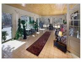 Enjoy the bright sunroom overlooking the patio and gardens.