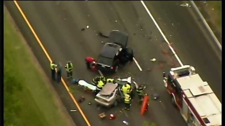 State police say a Rhode Island woman has died after the sedan in which she was riding was struck by an SUV that crossed to the wrong side of Interstate 95 south of Boston.