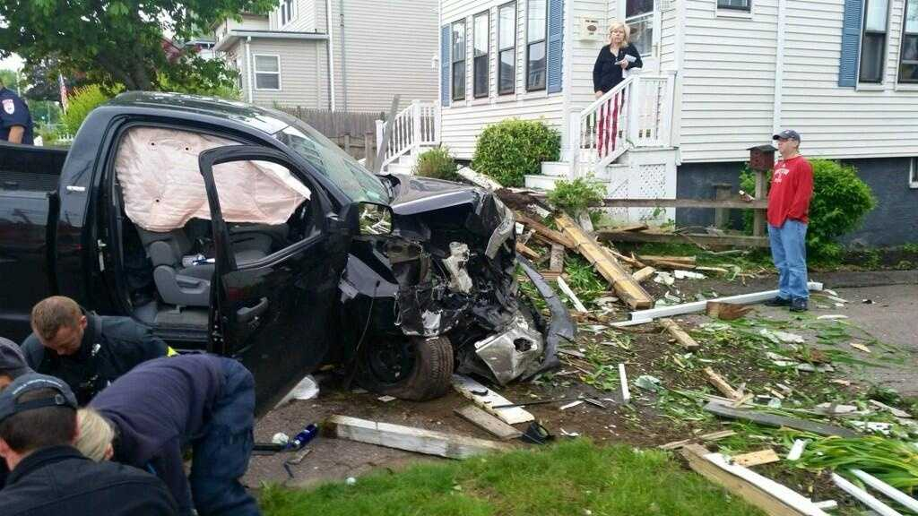An SUV plowed into two homes in Winthrop on Saturday, firefighters said.
