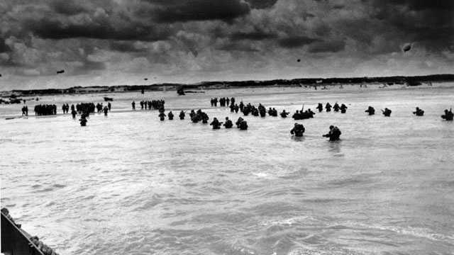 """At 6:30 a.m., troops began coming ashore on a 60-mile front. In a broadcast to the people of occupied Europe, Eisenhower said: """"Although the initial assault may not have been in your own country, the hour of your liberation is approaching."""""""