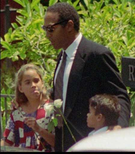 Simpson, with daughter Sydney, and son Justin, arrives at a private funeral for his ex-wife Nicole Brown Simpson in the Brentwood section of Los Angeles, June 16, 1994.