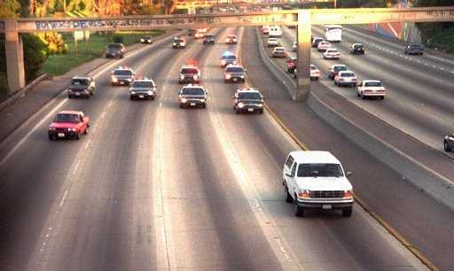 A white Ford Bronco, driven by Al Cowlings and carrying O.J. Simpson, is trailed by police cars as it travels on a southern California freeway on June 17, 1994, in Los Angeles. Cowlings and Simpson led authorities on a chase after Simpson was charged with two counts of murder in the deaths of his ex-wife and her friend.