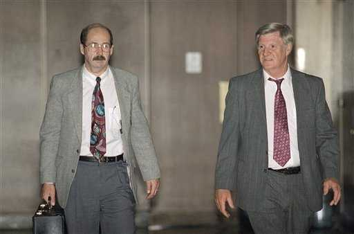 Homicide investigators from the Los Angeles Police Department Tom Lang, left, and Phillip Vannatter leave the Grand Jury room for a break during testimony to consider indictment of O.J. Simpson on a double murder charge in downtown Los Angeles on June 21, 1994. The grand jury was dismissed because of pre-trial publicity.