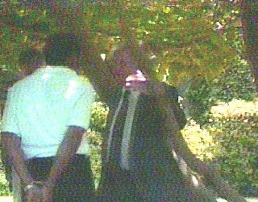 Los Angeles Police Department personnel talk to a handcuffed O.J. Simpson at his home in Los Angeles, June 13, 1994. Just after midnight, Simpson's ex-wife Nicole Brown Simpson and Ronald Goldman were found dead outside her Los Angeles home. Simpson's attorney showed up and after talking to police, they removed the handcuffs before taking Simpson for questioning.