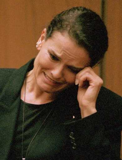 Denise Brown, sister of murder victim Nicole Brown Simpson, wipes her eye while testifying in this Feb. 3, 1995 photo. She said she witnessed Simpson pick up his wife and hurl her against a wall, then physically throw her out of their house after an argument.