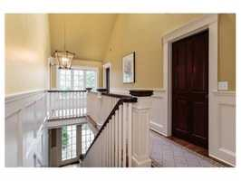 The home is architecturally rich in custom mill work and quality period craftsmanship.