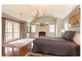 A stunning master suite with fireplace.