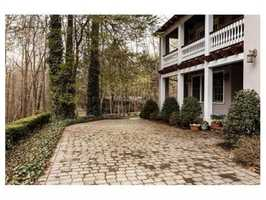 Ared brick patio and two car garage complete this gracious Belmont Hill residence.