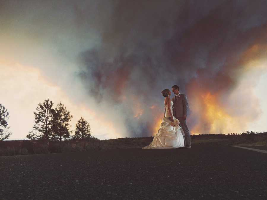 As guests headed for the cars, wedding photographer Josh Newton took some photos of the couple with the wildfire raging in the background.