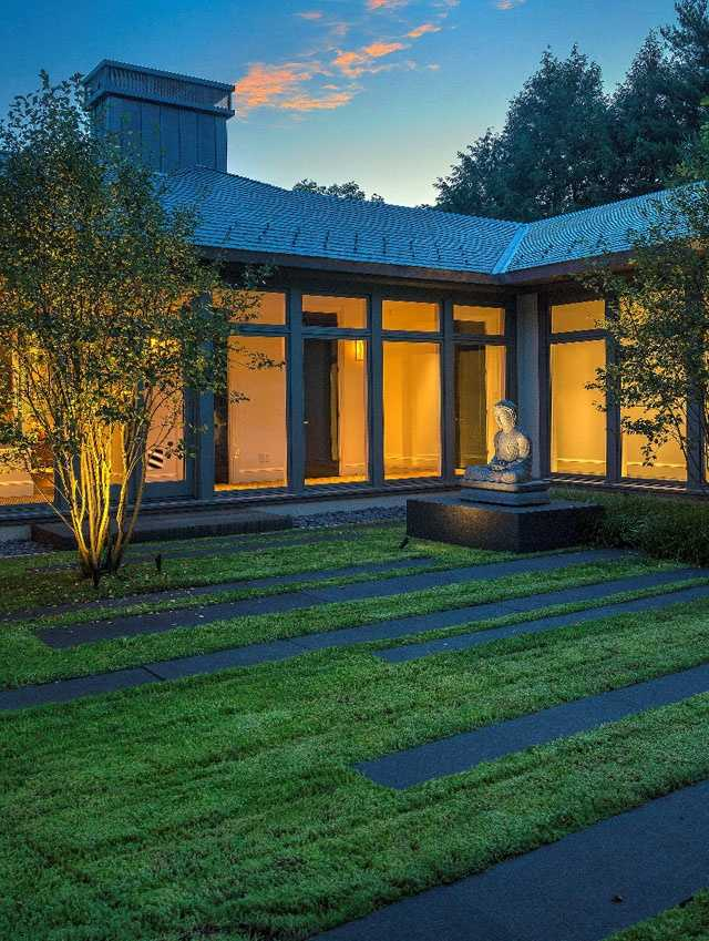 The sellers, Doug Sharon and his wife Nanci, spent nearly $10 million building the home in Brookline, which sits on four acres.The home features walls of windows that provide views of the landscape.