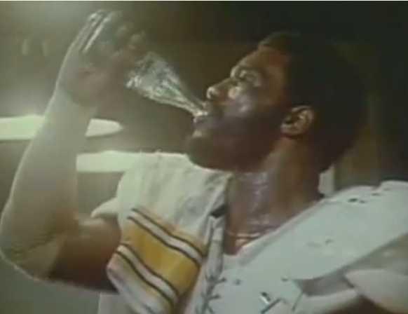 Mean Joe Green drinks Coke