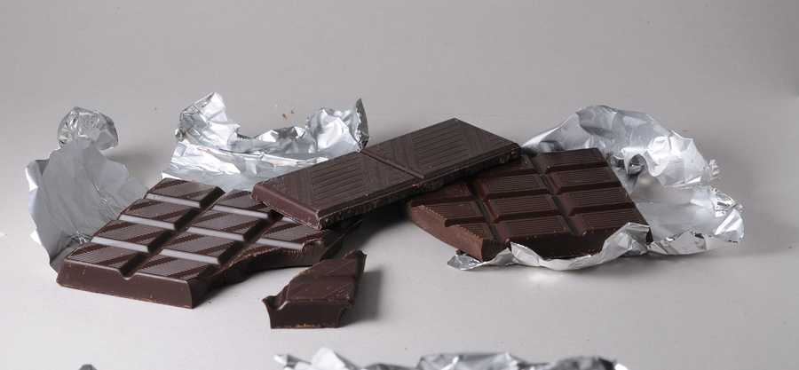 It's more filling than milk chocolate and may help curb cravings for both sweet and salty foods.