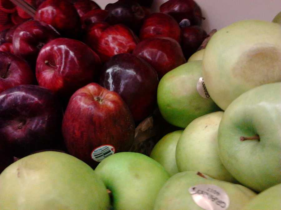Eating one 30 minutes before a meal will help. The fiber and water from the apple will fill you up.