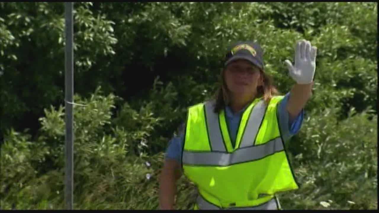 Dancing traffic guard helping Newtown heal