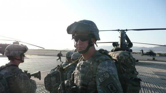 Sgt. Ryan Pitts waits for a flight at Bagram Airfield, Afghanistan.