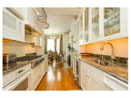 Chef's kitchen equipped with wine refrigerator and top of the line appliances