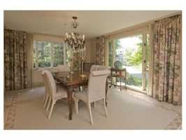 A formal dining room with built-ins