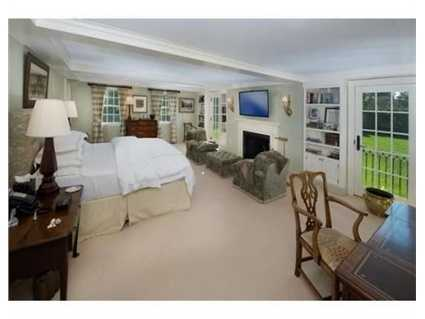 The enormous master suite has a spacious en suite marble bath with radiant heat.