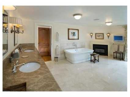 There are 4 full bathrooms and 2 partial baths.