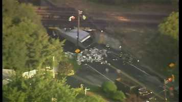 A truck hit an overpass in Westwood, causing delays for the Tuesday morning commute.