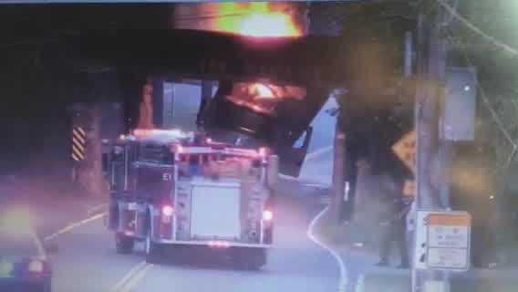 Uncut: Truck catches fire after crashing into bridge