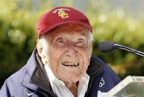 "Louis Zamperini was an Olympic distance runner and World War II veteran who survived 47 days on a raft in the Pacific after his bomber crashed, then endured two years in Japanese prison camps. Zamperini is the subject of Laura Hillenbrand's best-selling book ""Unbroken: A World War II Story of Survival, Resilience, and Redemption,"" which is being made into a movie directed by Angelina Jolie. (January 26, 1917 – July 2, 2014)"