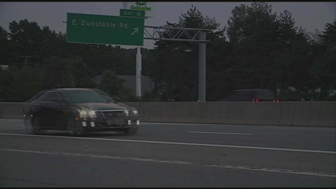 State police say one person has been charged and they are searching for a second after a trooper saw two cars racing along the Everett Turnpike on Wednesday.