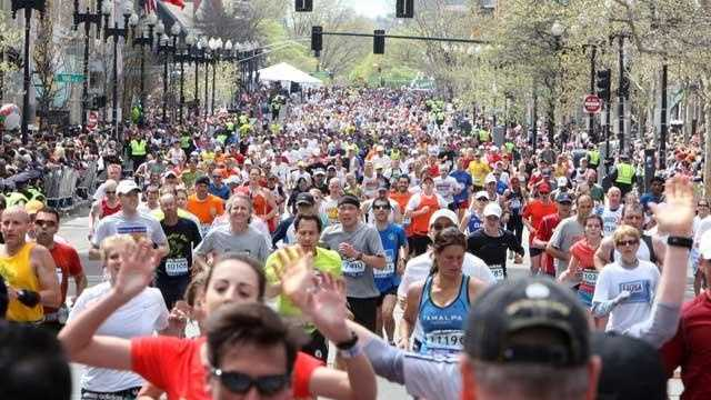 Boston Marathon runners head to the finish line on Boylston st. in Boston