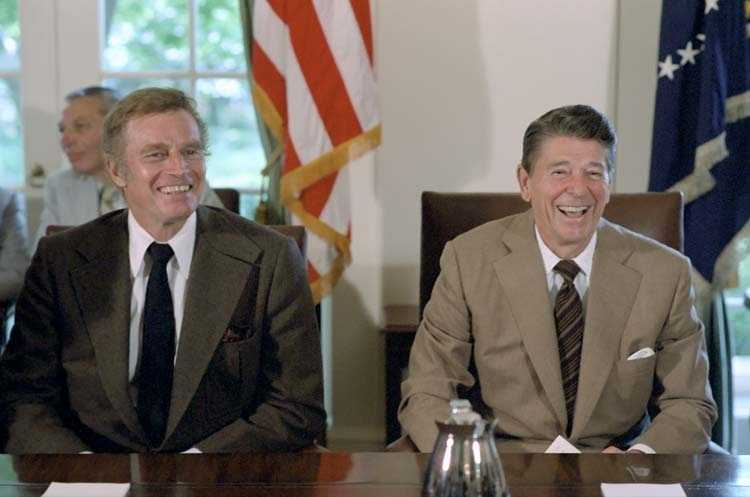 Actor Charlton Heston and Ronald Reagan at a meeting in the White House. Both of them would later be diagnosed with Alzheimer's disease.
