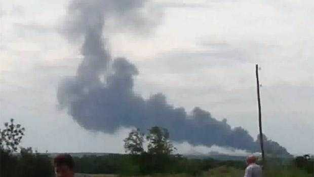 A passenger plane carrying 295 people was shot down Thursday over a town in eastern Ukraine.