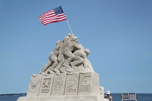 At the top, the iconic image of the American flag being raised at Iwo Jima in 1945.