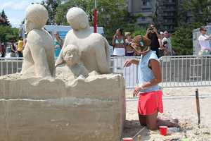 On Revere Beach Friday, sand sculptors were putting the finishing touches on their work for the 2014 National Sand Sculpting Festival.