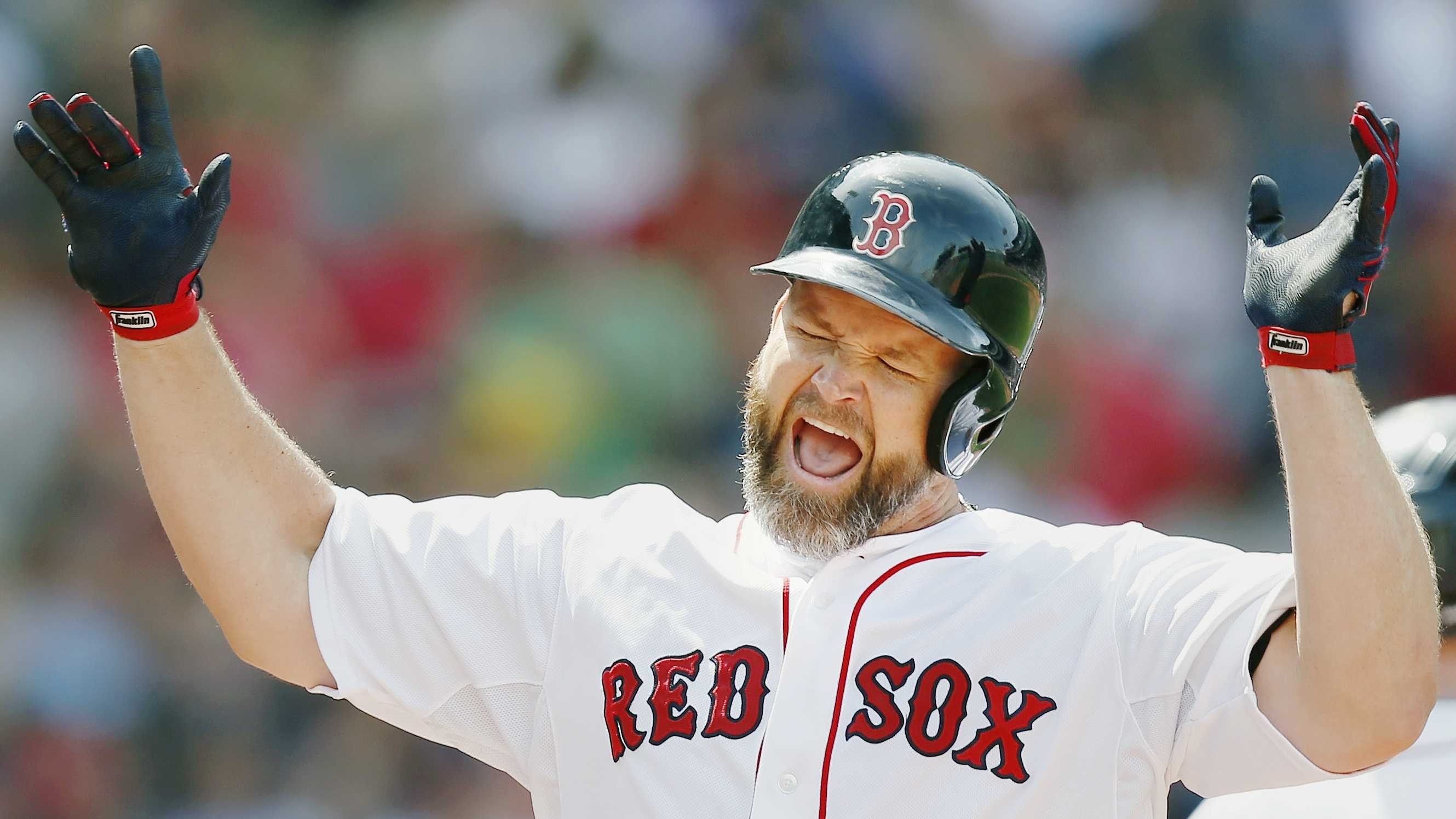 Boston Red Sox's David Ross celebrates his two-run home run during the fourth inning of a baseball game against the Kansas City Royals in Boston, Sunday, July 20, 2014. (AP Photo/Michael Dwyer)