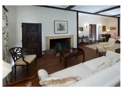 There's aball room size living room with double fireplaces.