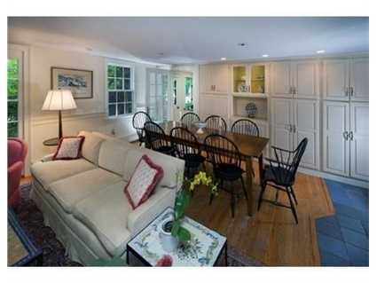 The kitchen has an adjacent family room.