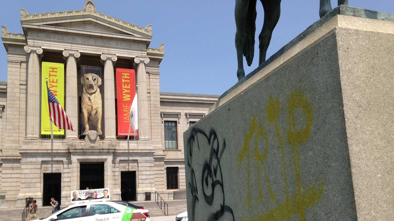 Images of Homer Simpson and other graffiti were found spray painted Friday on exterior walls of Boston's Museum of Fine Arts and on the base of a statue at the main entrance.