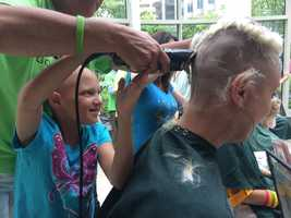 A group of mothers from around the country trekked to Boston Sunday to have their heads shaved in support of children with cancer.