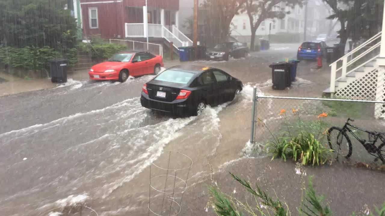 Rushing water floods Somerville street