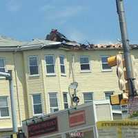 The roof of this triple decker was damaged by the storm.