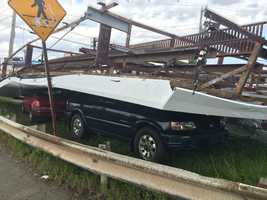 This billboard at the Route 107 rotary crashed onto cars in Revere on Monday.