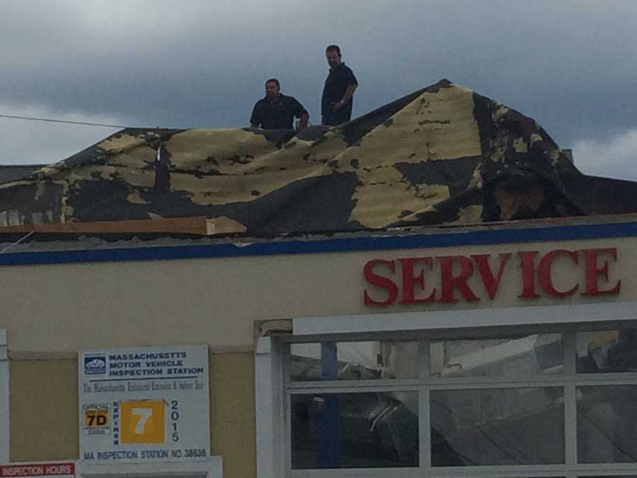 The roof of this Revere auto repair shop's roof was torn off.