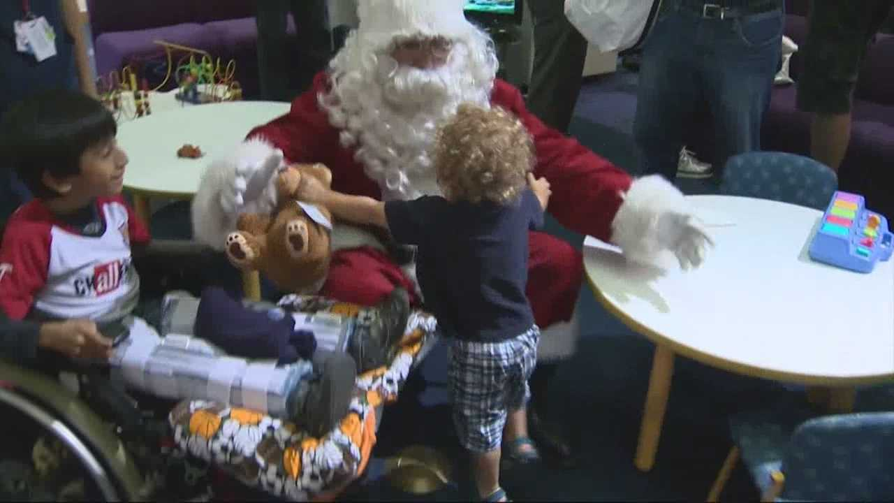 Santa makes a visit to patients at Shriners Hospital for Children