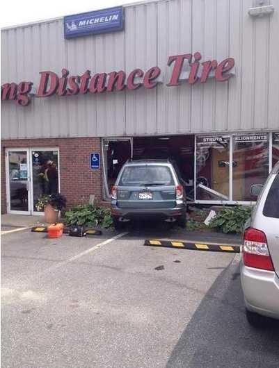 A vehicle crashed through a front window at Long Distance Tire in Medway around 2 p.m. on Friday.