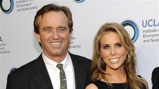 This March 21, 2014 file photo shows actress Cheryl Hines, right, posing with her fiance Robert F. Kennedy Jr., at the UCLA Institute of the Environment and Sustainability's An Evening of Environmental Excellence in Beverly Hills, Calif.
