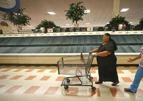 Maria Arvarado, of Haverhill, Mass. finds empty produce bins as she shops Thursday, July 24, 2014 at Market Basket supermarket in Haverhill, Mass.