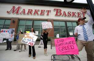 Market Basket employees Rees Gemmell, far right, and colleagues acknowledge passing supporters as they picket in front of the supermarket Thursday, July 24, 2014, in Haverhill, Mass.